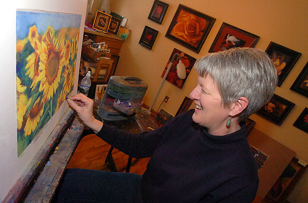 Loveland artist Bill Colson works on a pastel Thursday in her home studio. Colson has been instrumental in helping band artists together to market their work. She organized the Night on the Town and the Loveland Art Studio Tour and Sale.