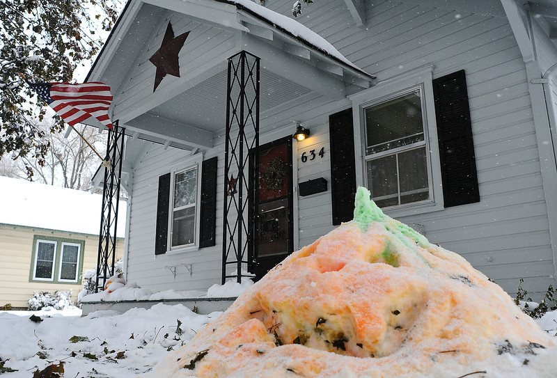 A snow pumpkin foreshadows a wintry Halloween at a home on Seventh Street and McKinley Avenue on Wednesday.