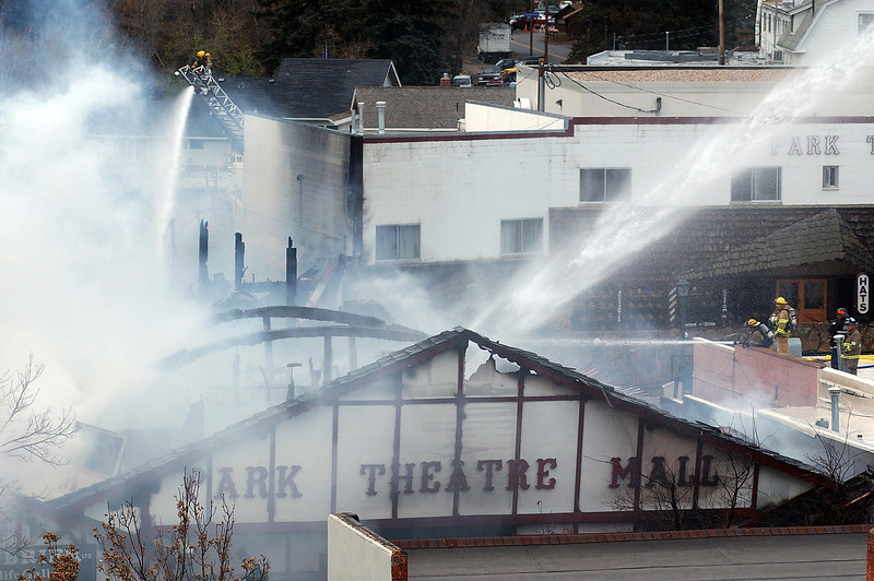Firefighters from at least eight departments battle a fire that engulfs the Park Theatre Mall on Monday in Estes Park.