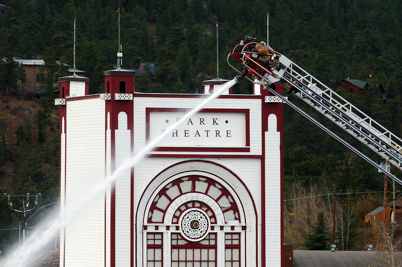 A firefighter fights a blaze from atop a tower truck during a fire that engulfed the Park Theatre Mall on Monday in Estes Park, Colo. The adjacent theatre was not damaged in the fire.<br /> <br /> AP Photo/Loveland Reporter-Herald, Chris Stark