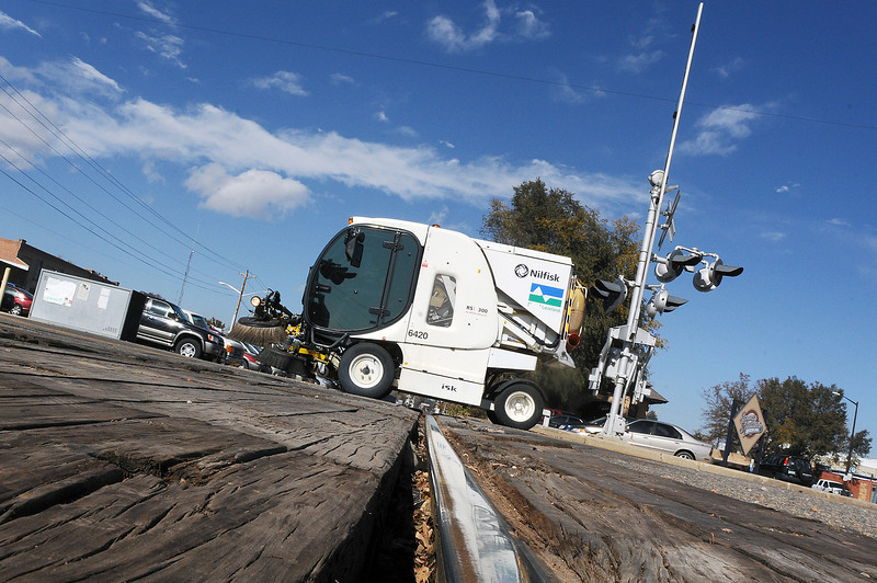 A street sweeper rolls over the railroad crossing as it travels westbound on Fourth Street in downtown Loveland. The crossings at Fourth and Sixth Streets will be repaired in the upcoming weeks with work starting on Sixth Street on Oct. 19 and on Fourth Street on Oct. 26. Expect closures at each intersection to last a week, weather permitting.
