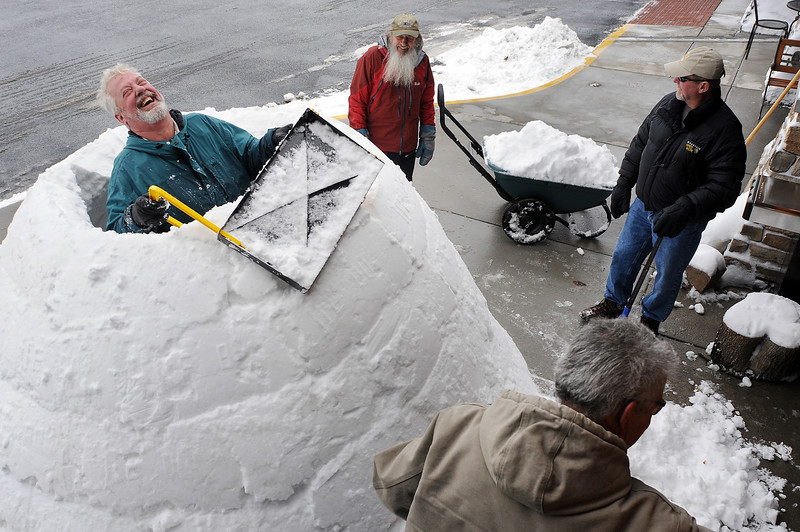 "John Kole, left, of Fort Collins kids around with friends, clockwise from Kole, Ed Huesers of Lyons, Jim Foppema of Fort Collins, and Bob Reihsen of Loveland as they build an igloo in front of JAX Outdoor Gear in Loveland. Huesers, also known as ""Igloo Ed,"" invented a device used to make the ancient shelters. They built the igloo to promote the device, which the store now carries."