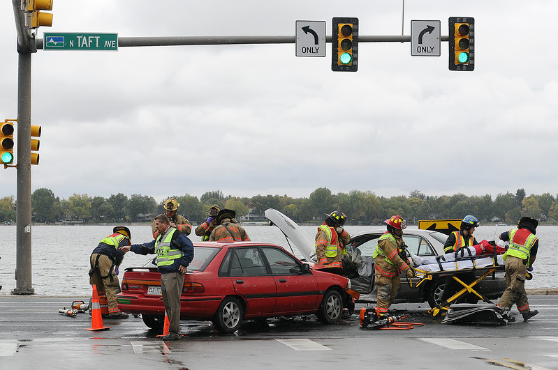 Loveland Fire and Rescue and Loveland Police work the scene of an accident on Thursday afternoon that involved two cars on North Taft Avenue and West 22nd Street. The accident tied up traffic for about an hour until crews cleared the area.