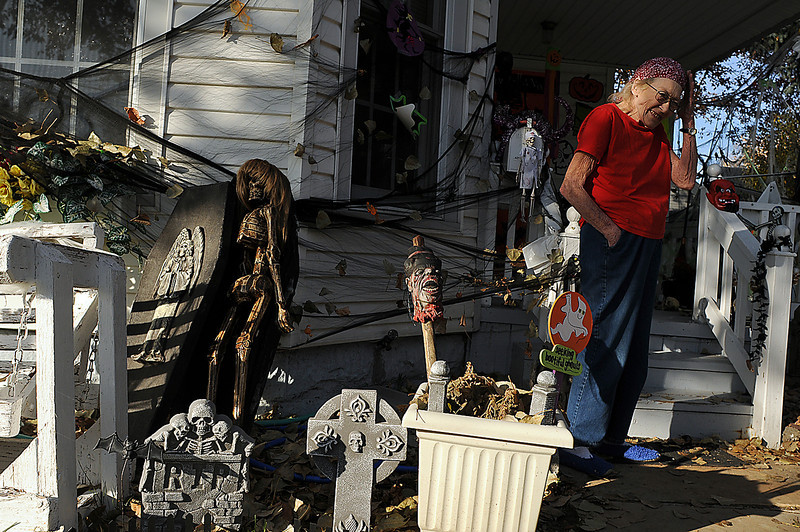 Nola Bracy talks about the decorations in her yard and on her house on Third Street on Thursday. Bracy's granddaughter, Andrea Yoder and her friends Emily and Liz Rock spent several nights and early mornings decorating the house for Bracy, who is battling cancer.