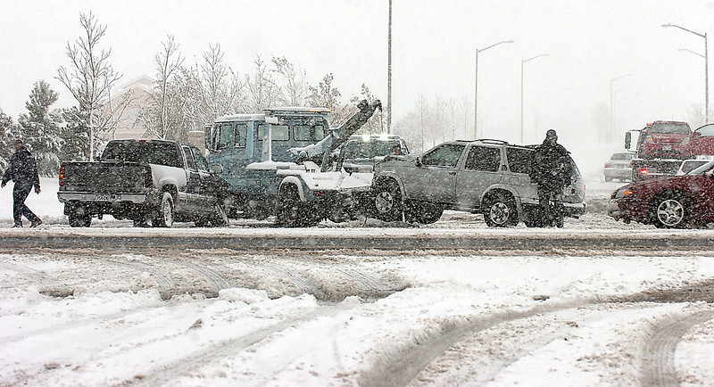 Loveland Police investigate the scene of an accident at 50th Street and Taft Avenue Wednesday in Loveland. According to Loveland Police Sgt. Benjamin Hurr there were 17 accidents in Loveland as of 3pm but the city did not go on accident alert. There were no serious injuries in the accidents.