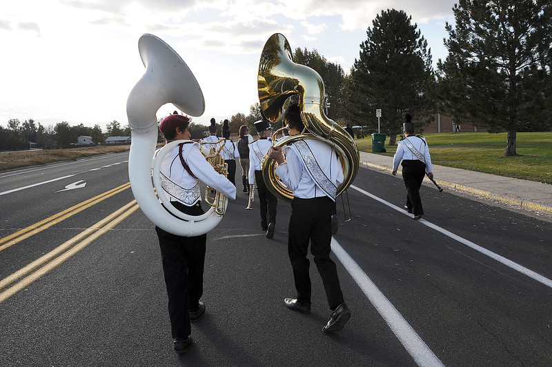 Berthoud High School Spartan Marching Band Sousaphone players Alan Coone, left, and John Johnson walk down Eagle Drive on Wednesday after performing at the Northern Regional Band Competition at Thompson Valley High School on Wednesday.