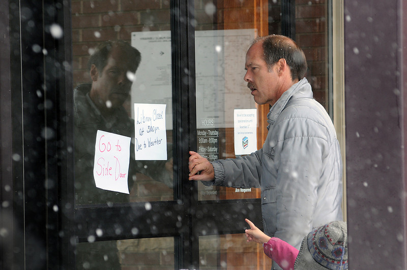 Mike Goar and his daughter Zoanna, 5, try the door of the Loveland Public Library during a snow storm that took out the power to the building. The public was still able to access the building through a side door but the library was unable to conduct business and closed at 3:00 p.m., like other public buildings because of the weather.
