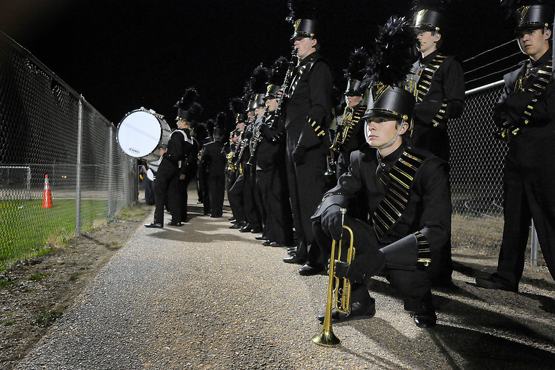 Thompson Valley High School senior Graham Geary kneels with his trumpet before the start of his band's performance at the Northern Regional Band Competition at Thompson Valley on Wednesday.