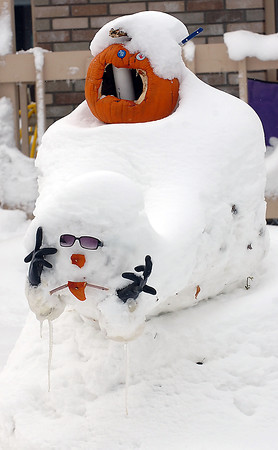 A humorous Halloween themed snowman decorates a yard on the 1900 block of Hyde Drive Thursday in Loveland.