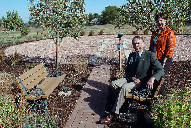 McKee Medical Center chaplain Bruce Rippe, left, and Penny Rollins, who leads McKee's Care and Healing Team, pose in front of the meditation labyrinth at Pathways Hospice in Fort Collins on Thursday. McKee Medical Center will build its own labyrinth on Oct. 19 and 20 near the Wellness Walk, a three-quarter mile trail on the hospital's campus.