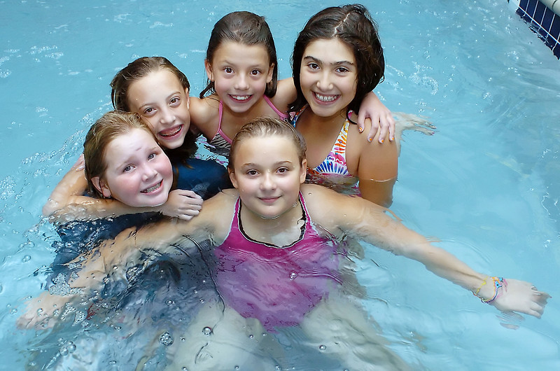 Haley Wade, front, poses with some friends during a pool party Saturday celebrating her birthday. Back from left are Reagan Faughnan, 10, Cloey Rogers, 10, Cecilia Velarde, 7, and Deidre Sandoval, 10. Haley turned ten years old on Sunday, when the date was 10/10/10.
