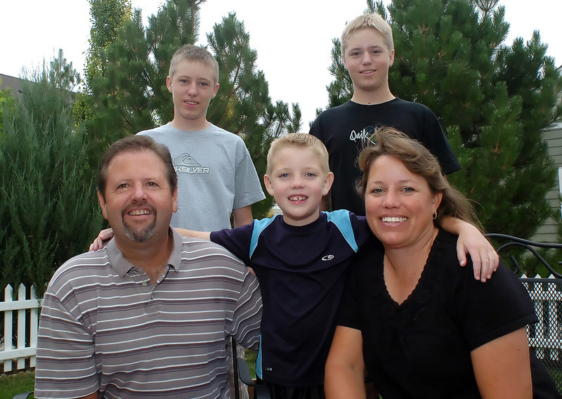 Members of the Woods family pose together Sept. 22, 2010 in the backyard of their home in Loveland, Colo. Front from left are Paul, Matt, 8, and Jennifer and at rear from left are Kyle, 15, and Jake, 15.