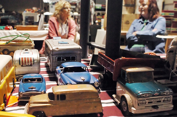 A variety of toy cars and trucks from the 1930's to 1950's are displayed at the Timber Dan Antique and Collectible Toy Show on Saturday as Heidi Holthe, left, of Rochester, Min. and Johnstown resident Carolyn Carlson chat during the show.