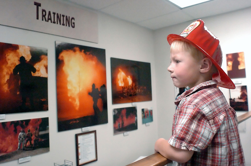 Four-year-old Sam Topham looks at one of the displays at the Loveland Fire Exhibit on Saturday in the Loveland Museum/Gallery Sequel building while attending an open house there with his mother, Annette, not pictured.