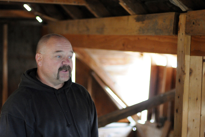 Gary Moon, the owner of the property which the Charles Meining House was found, speaks in the loft of the building Saturday. Moon, who has owned the property for 21 years, lived in the Meining house for 10 years before donating it to the Berthoud Historical Society.