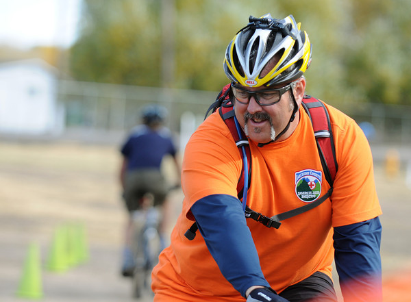 Brian Walsh navigates a cone course with his bike as part of the training program for the Larimer County Search and Rescue Mountain Bike Team in North Fort Collins Saturday. The training program focuses on the fundamentals of biking with excercises meant to help wiht slow speed technique and rules of the road.