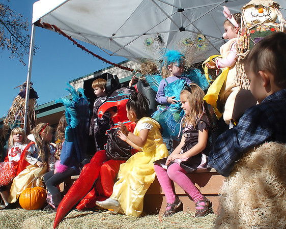 Youngsters in the 4 to 5-year-old bracket parade onstage in front of the judges while competing in a costume contest Saturday during the Halloween Family Fun Festival in downtown Loveland.