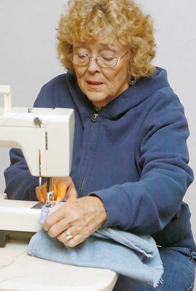 Loveland Odd Fellows Lodge volunteer Linda Marshall sews a bag using material from a pair of denim jeans on Tuesday at the lodge's location in downtown Loveland. The bags will be filled with toiletry items like toothbrushes, toothpaste, bar soap and shampoo and then be distributed to homeless individuals in Loveland.