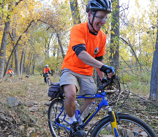 Jim Rabold, the Larimer County Search and Rescue Mountian Bike Team Coordinator, rides down an obstacle course as part of a training program for the team Saturday in North Fort Collins. The training program is part of 4 part class totaling 32 hours to certify the team with the International Police Mountain Bike Association.