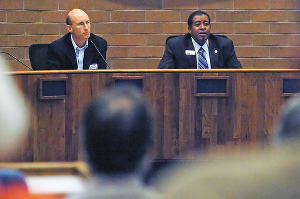 Larimer County Commissioner candidates Adam  Bowen, left, and Lew Gaiter participate in a debate Wednesday evening at the Fort Collins City Chambers.