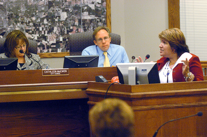 Hope McCorkendale, right, addresses the Loveland City Council during the citizens report portion of the meeting Tuesday evening. At rear from left are council members Cathleen McEwen and Kent Solt.