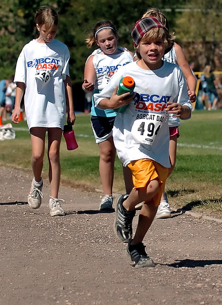 Ten-year-old Kasey Gault, front, makes his way around the track outside Mary Blair Elementary School on Wednesday while participating with classmates in the Bobcat Dash fundraiser.