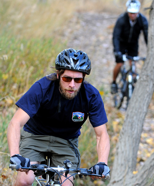 Brendan Murphy, a member of the Larimer County Search and Rescue Mountain Bike Team, rides on a trail during a day of training at the Larimer County Emergency Services Cache in North Fort Collins. The Mountain Bike Team is trying to achieve a certification of Emergency Medical Services cyclists from the International Police Mountain Bike Association.