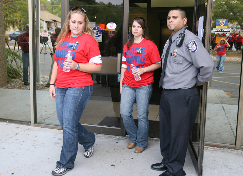 Nikki Hartley, David's sister, and Tia Young, Tiffany's sister, walk out of the Mexican Consulate during a protest on Friday in Denver. (Photo by Gabriel Christus)