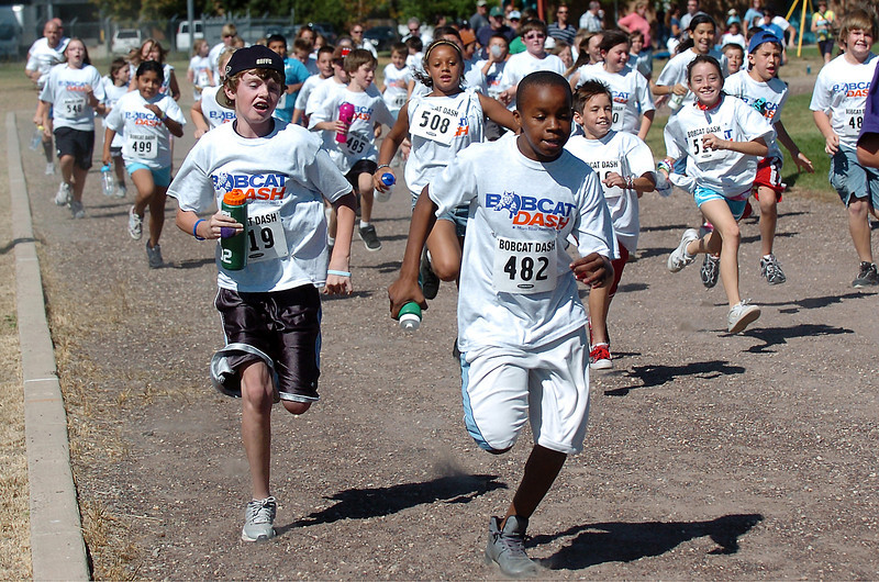 Mary Blair Elementary School fifth graders Nick Messinger, 10, left, and Semaj Spencer, 10, run with their classmates on the track outside the school on Wednesday at the start of the Bobcat Dash fundraiser. As of Wednesday they had raised $14,223.65 to help pay for improvements to the school like Promethean interactive whiteboards for each classroom. Donations are being accepted through today and can be dropped off at the school, 860 E. 29th St., in the main office. If they reach their goal of $15,000 then the principal will get slimed during an assembly at the end of the school day.