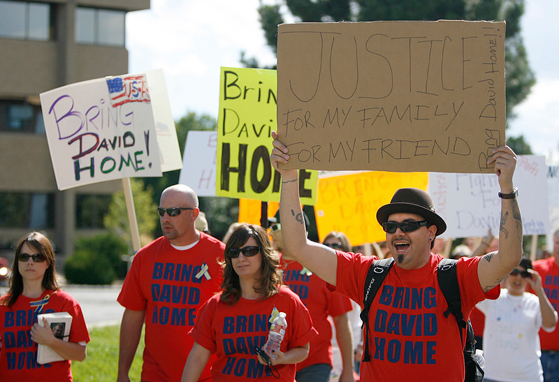 "Russ Rodriguez holds up a sign while chanting ""Bring David home!"" during a protest Friday at the Mexican Consulate in Denver. (Photo by Gabriel Christus)"