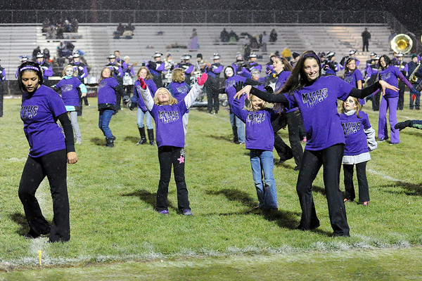 """Youngsters dance like zombies while Mountain View High School's marching band plays the song """"Thriller"""" during halftime of their football game against Greeley West on Thursday, Oct. 25, 2012 at Patterson Stadium."""