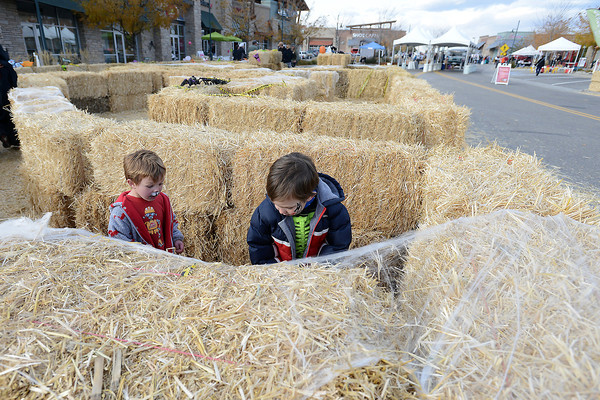 Berthoud residents Albie Dabbiero, 2, left, and his brother Giovanni Dabbiero, 4, look a a mummy figurine hidden among hay bales as they play in the Not-So-Spooky Hay Maze during the Halloween Hullabaloo event on Saturday, Oct. 27, 2012 at the Marketplace at Centerra. The maze was a fundraiser for Thompson Valley High School's marching band.