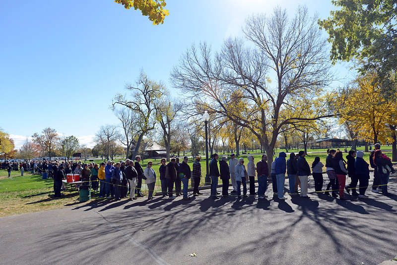 A line forms for attendees filing into Island Grove Regional Park's Exhibition Hall to hear a speech by vice president Joe Biden during a campaign stop on Wednesday, Oct. 17, 2012 in Greeley, Colo.