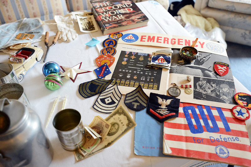 A variety of artifacts from the World War II era are displayed on a table during the Women on the Homefront During World War II event on Saturday, Oct. 20, 2012 at the McCarty-Fickel Home Museum in Berthoud.