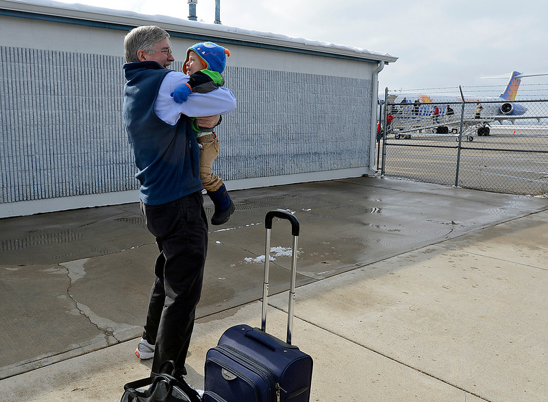 Rowan Benton of Loveland, 2, greets his grandpa David Parks Friday after Parks flew in from Las Vegas to visit family on one of the last Allegiant Air flights in and out of Loveland. Parks, who lives in Las Vegas, flies to Loveland on Allegiant Air 3-4 times a year to see his grandson.