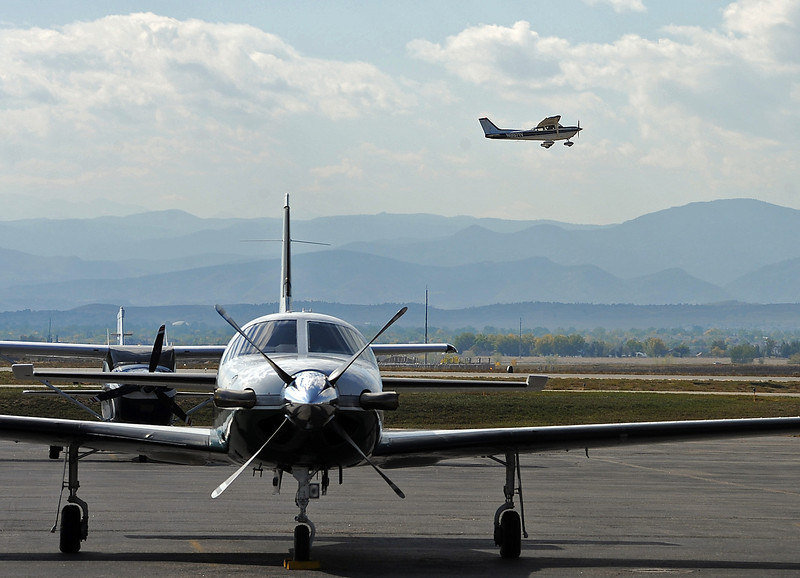 An airplane flies past other aircraft on the tarmac as it takes off from the Fort Collins-Loveland Municipal Airport Monday in Loveland.