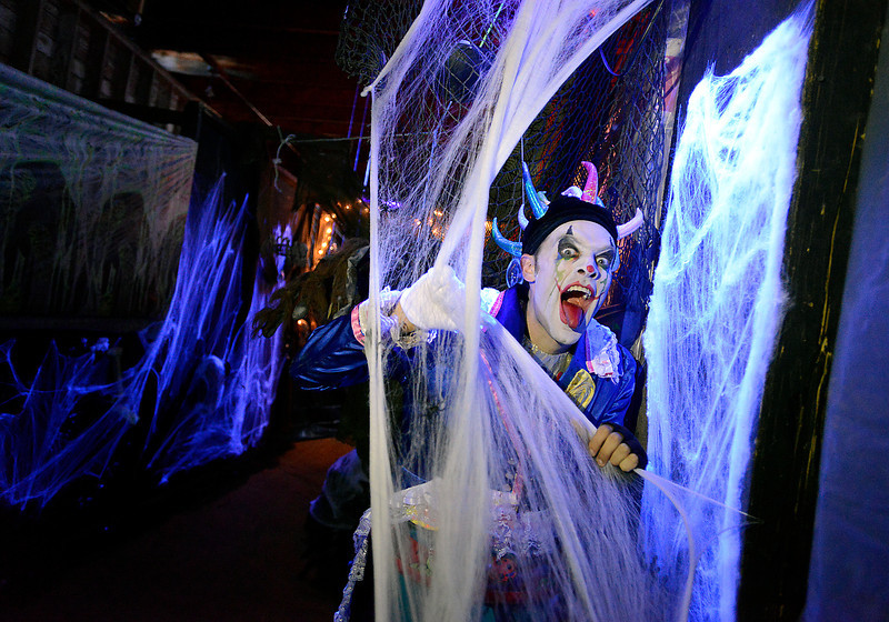 Brandon Harrington poses for a photo showing off one of the spooky areas in the haunted house, run by Harrington Arts Academy, at the Feed and Grain building Wednesday in downtown Loveland.
