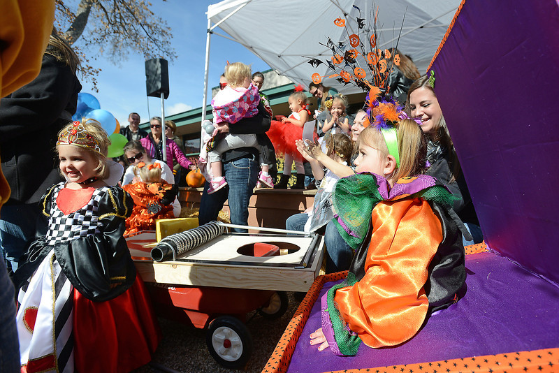 Johnstown resident Jadyn Lindsay, 3, left, and Ella Raabe, 2, right, of Loveland compete in a costume contest with other youngsters during the Halloween Family Fun Fest on Saturday, Oct. 27, 2012 in downtown Loveland.