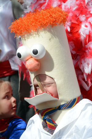 Elliot Milden, 6, sits onstage in his Beaker costume while competing with other youngsters in a costume contest during the Halloween Family Fun Festival on Saturday, Oct. 27, 2012 in downtown Loveland.