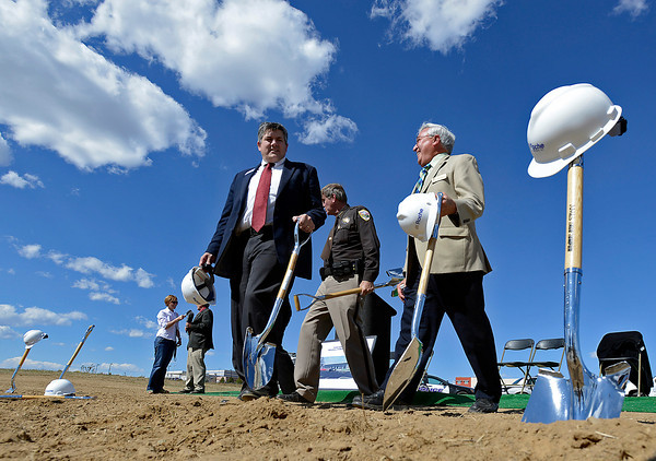 Larimer County Commissioner Tom Donnelly, left, Weld County Sheriff John Cooke, center, and Loveland Mayor Cecil Gutierrez, right, chat after breaking ground for the new Regional Crime Lab in Greeley on Wedensday.