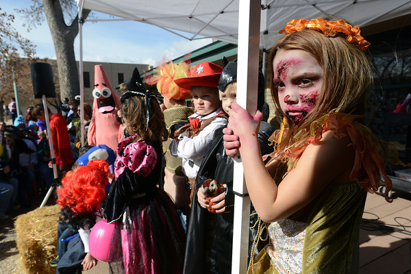 Five-year-old Paitynn Leicht, right, is dressed as a zombie girl as she stands with other costumed youngsters during the Halloween Family Fun Festival on Oct. 27, 2012 in downtown Loveland.