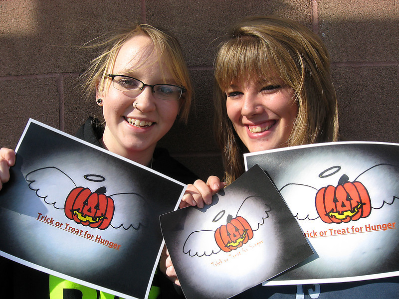 "Jayde Graber (left) and Savannah Morgen, both seniors at Mountain View High School, are inviting groups in the community to ""trick-or-treat for hunger"" on Oct. 31 for Halloween. Group members are encouraged to print out the official logo at  <a href=""http://www.reporterherald.com"">http://www.reporterherald.com</a>."