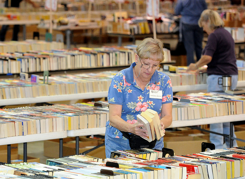 Volunteer Virginia Brant organizes and sorts book Friday in preparation for the Friends of the Library used book sale this weekend at The Ranch in Loveland.