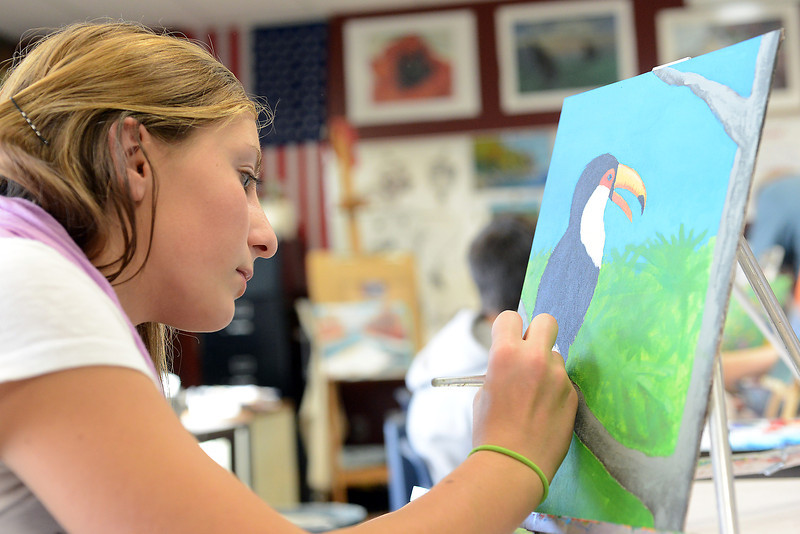 "Resurrection Christian School freshman Maddi McDaniel, 14, paints with acrylic on canvas during art class Tuesday, Oct. 23, 2012 on a painting that will be auctioned off during the ""Art for Water"" event to raise money to build a well in Swaziland, Africa."