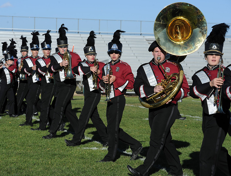 Members of the Berthoud High School Golden Eagles marching band compete during the Colorado Band Masters Association Northern Colorado Marching Band Competition at Patterson Stadium Wednesday in Loveland.