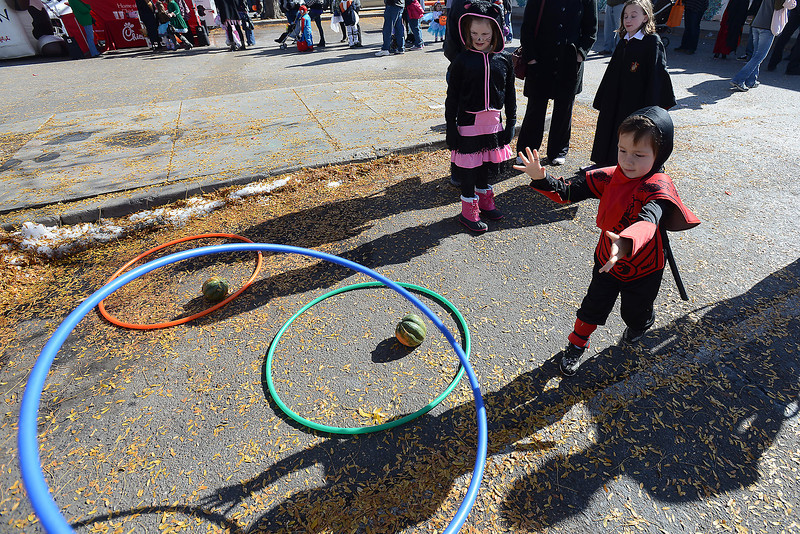 Ethan Ortiz, 4, is dressed as a samurai as he plays a ring toss game during the Halloween Family Fun Festival on Saturday, Oct. 27, 2012 in downtown Loveland.