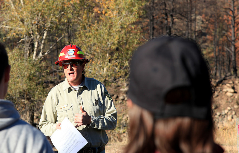 National Forest Service forester and silviculturist David Hattis briefs volunteers Saturday morning at the Upper Narrows campground along the Poudre River. Volunteers planted bushes and trees in fire-damaged and other areas as part of National Public Lands Day.