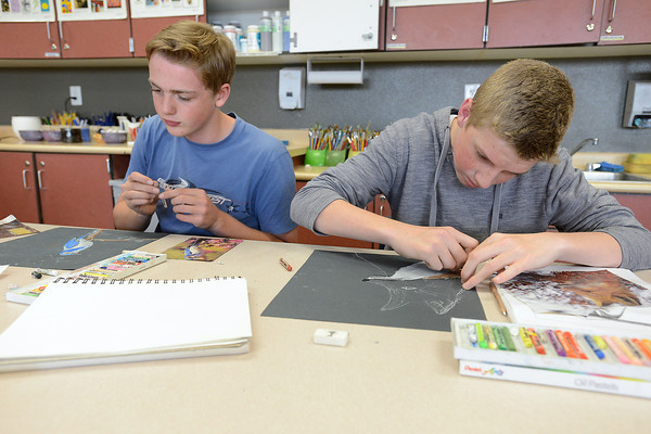 "Resurrection Christian School junior Jacob Wapnick, 16, left, and classmate Luke Wagner, 16, work on drawings using oil pastels during their 2-D art class on Tuesday, Oct. 23, 2012 in preparation for the upcoming ""Art for Water"" show and auction fundraiser."