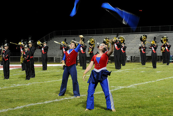 "Members of the Loveland High School Crimson Regiment marching band show off their performance ""Rhapsody in Red, White, Blue"" while competing Wednesday night during the Colorado Band Masters Association Northern Colorado Marching Band Competition at Patterson Stadium in Loveland. Rhapsody in Red, White, Blue."