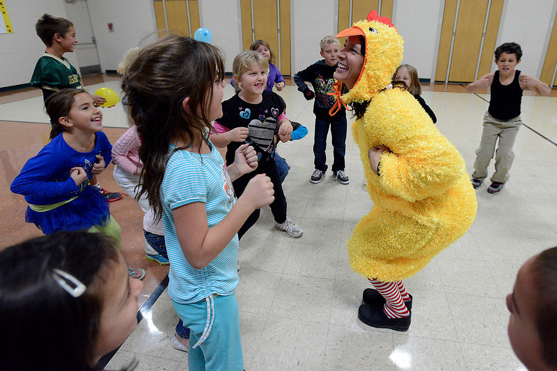 Sporting a chicken costume, Centennial Elementary School principal Anne Marie Sanchez does the chicken dance with second-graders Friday during a dance party recess. The kids in this class earned the party for having the highest percentage of participation in the Bald Eagle Boogie walk-a-thon fundraiser recently. The school raised over $15,000 and they hope to use the money to help create educational gardens and outdoor classrooms.
